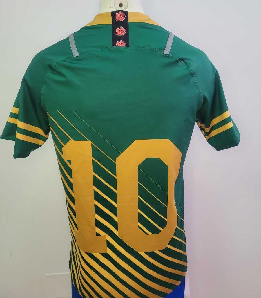 Camiseta de rugby en colores verde y amarillo